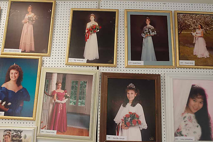 Formal portraits of former Apple Blossom Cotillion Queens in an exhibition at the Springfield Medical Center, which organizes the dance show.