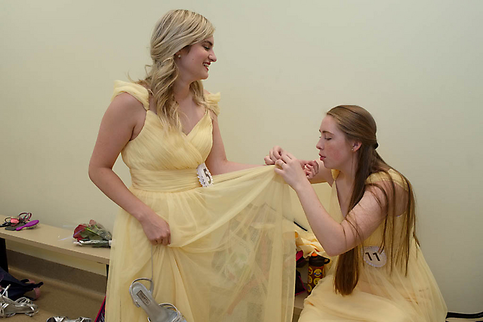 Gillian helps Laura to disentangle the tulle of her ballroom dress from her bracelet before they perform.