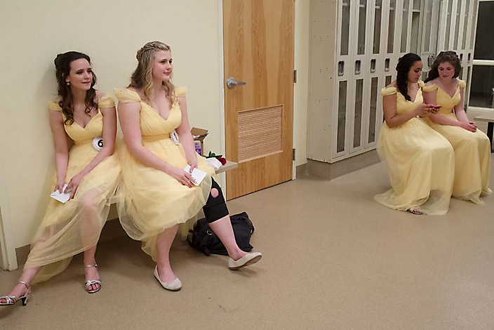 Intermission. Left: best friends Alyssa and Ainsley, who tore a knee ligament and has to dance with a brace. Sophia and Kylee check text messages on Sophia's cellphone.