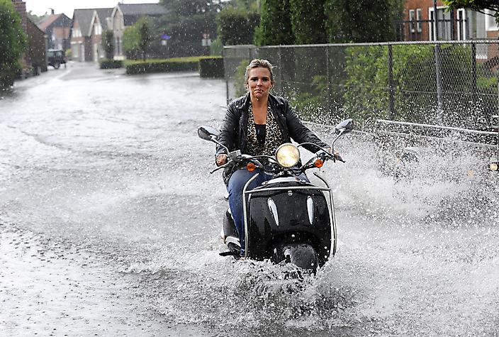 Fotojournalistiek. Wateroverlast na hoosbui.